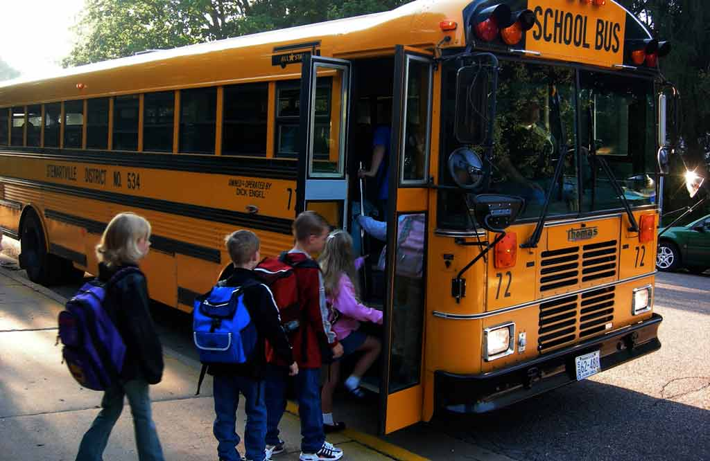 Image Creative Commons by Ty Hatch, school bus, children boarding